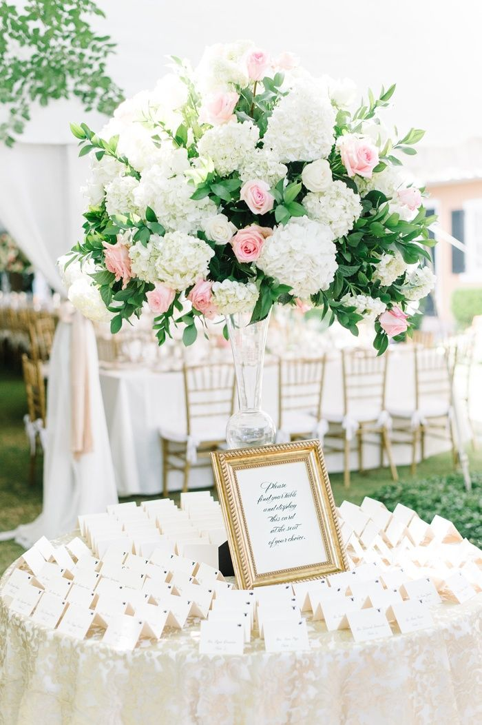 Classic Escort Card Display, Gold Details    Photography: Aaron and Jillian Photography   Read More:  http://www.insideweddings.com/weddings/romantic-southern-wedding-with-delicate-color-palette-in-charleston/979/