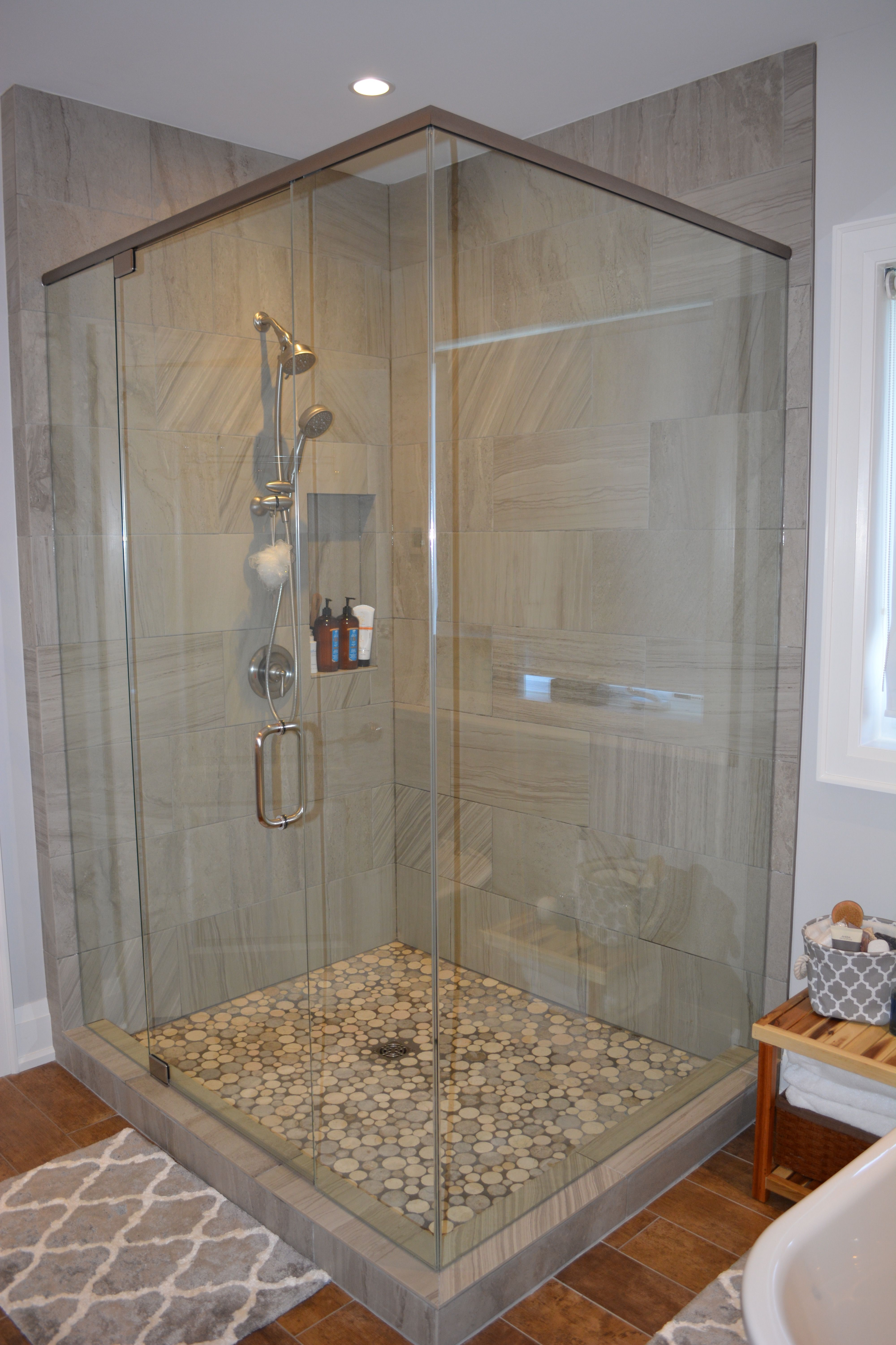 Glass corner shower with circle tile floor contrasting grout glass corner shower with circle tile floor contrasting grout wood grain ceramic tile and dailygadgetfo Choice Image