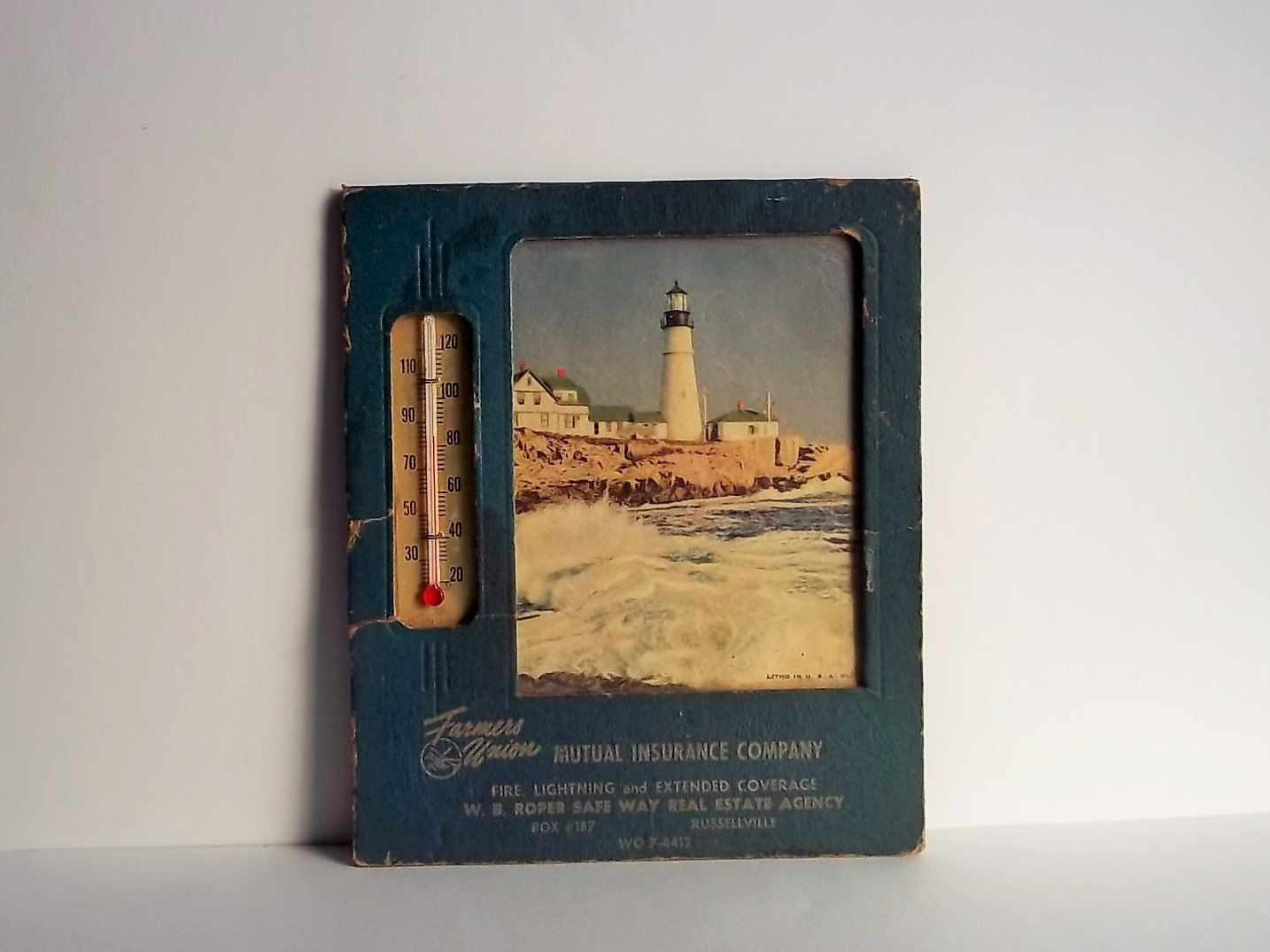 Insurance ad lighthouse thermometer litho in usa glco of
