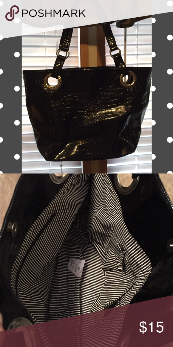Black tote Brand new. It's a little stiff but a very nice tote. 13 from top to w 15 across 18 inches on the straps Bags Totes