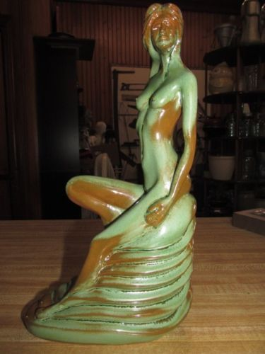 Green pottery nude girl on fish figurine