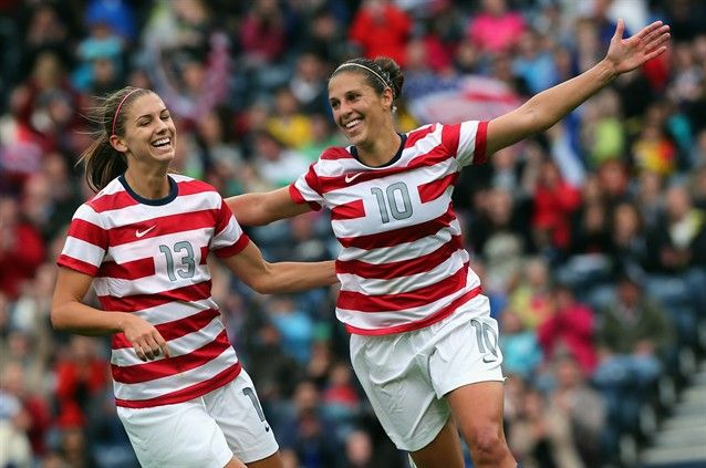 Carli Lloyd of USA (R) celebrates with teammate Alex Morgan after scoring their third goal during the Women's Football first round Group G match between United States and Colombia on July 28, 2012.