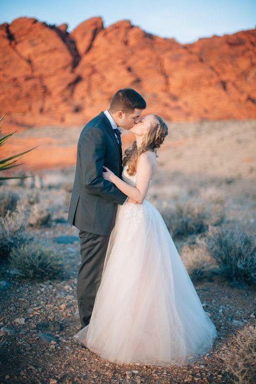 Zeita Studios Custom Pale Pink Wedding Dress. Photography by Love Is A Big Deal Vegas, Red Rock Mountains