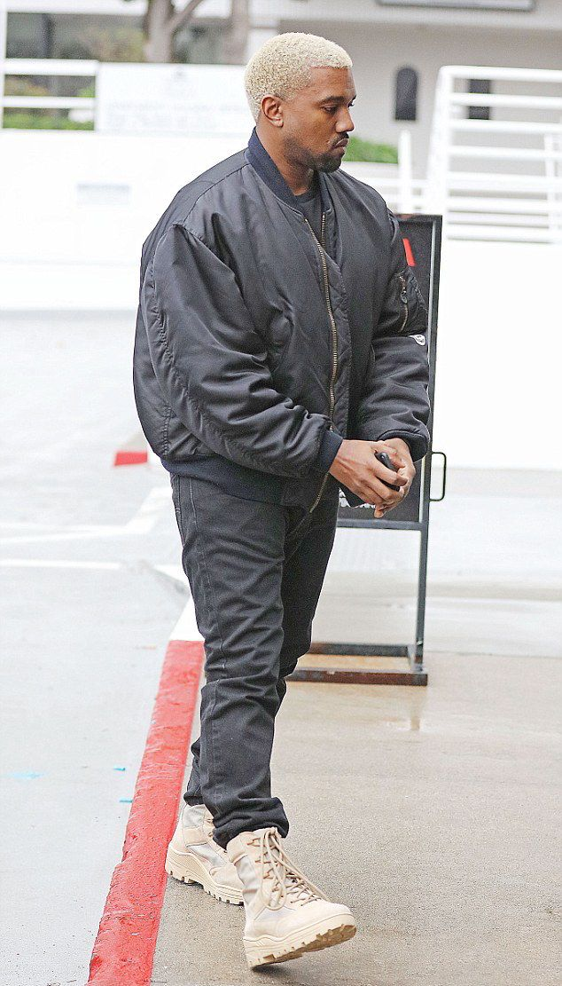 Kanye West Steps Out In Raf Simons Bomber Jacket And Yeezy