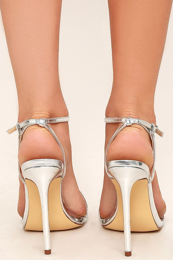Toulouse Silver Dress Sandals is part of Silver dress sandals - Set out in the Toulouse Silver Dress Sandals and bask in the city lights! Metallic vegan leather forms an asymmetrical strap that crosses the vamp and wraps around the ankle
