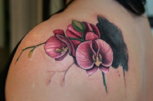 Shoulder Orchid Tattoo. No placement would get better than shoulder for this tattoo.