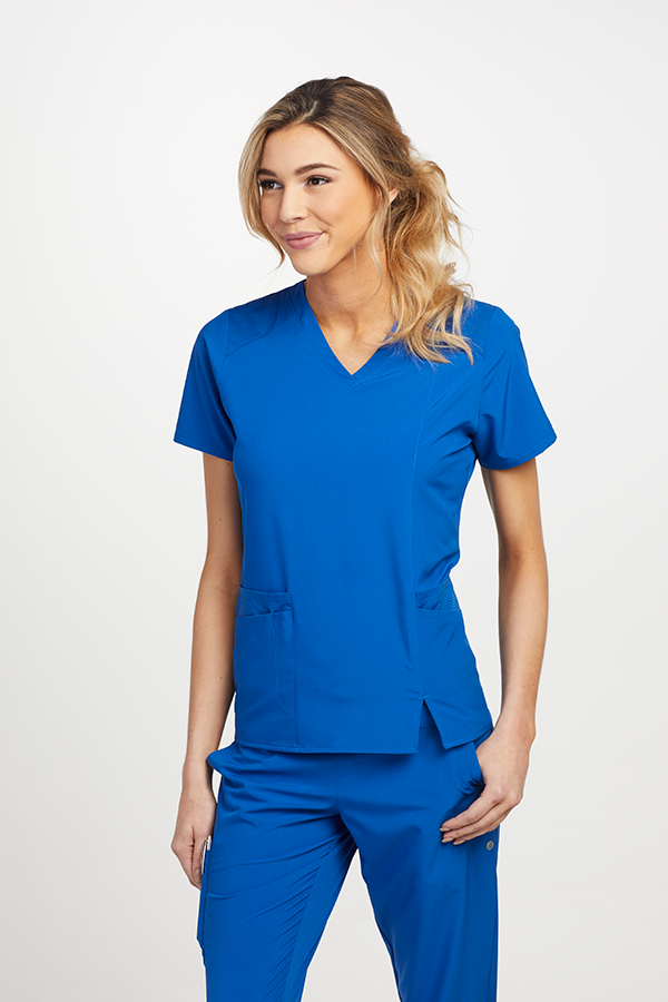 7f70e25d61e Highlighted by contrast panels, this Barco One Wellness Scrub Top adds a  cute twist to