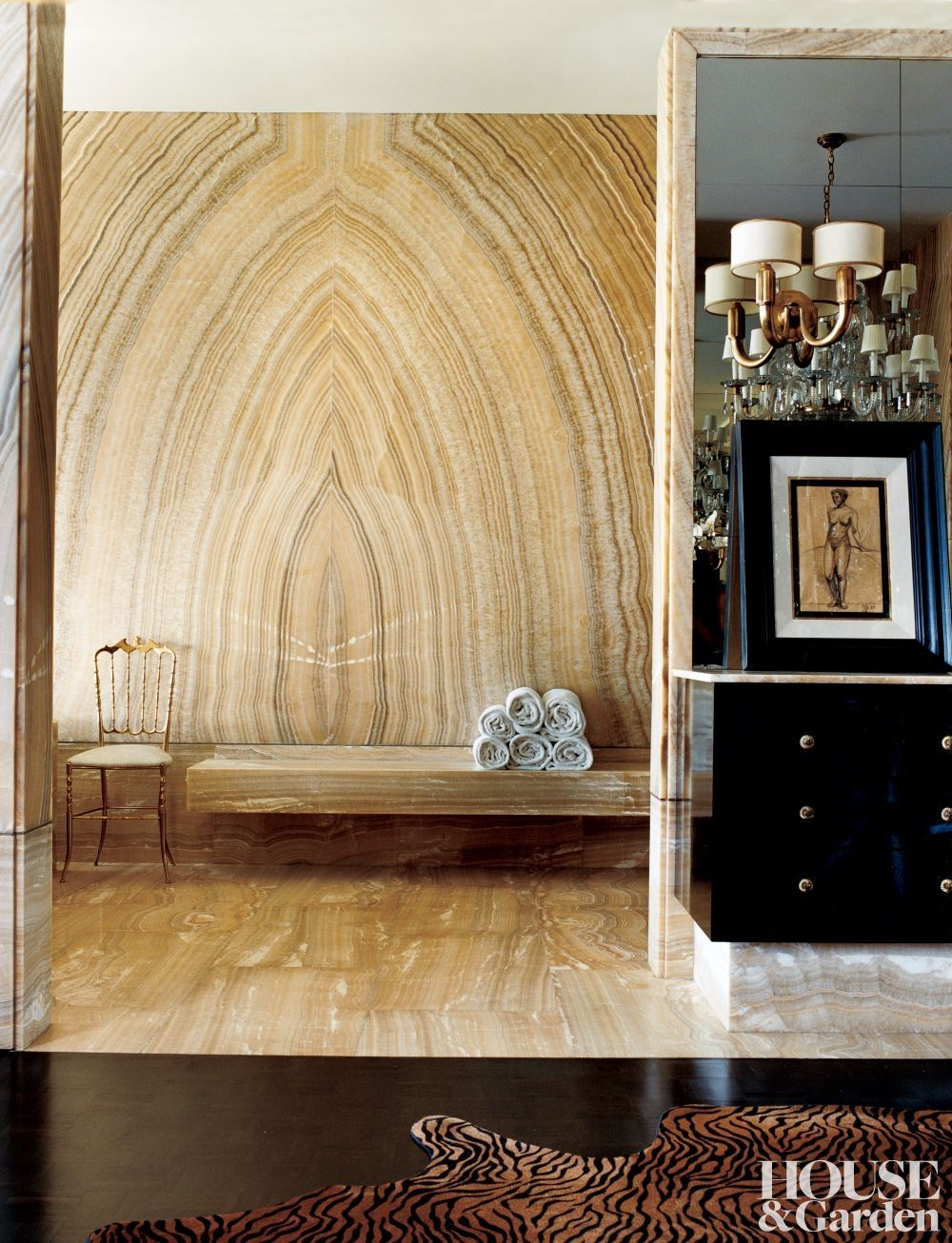 Amazing bookmatched onyx wall in a beverly hills home designed by