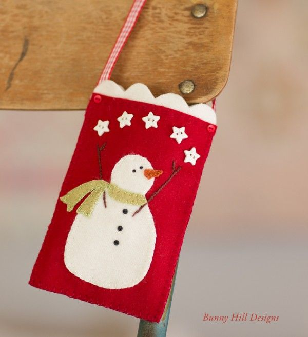 Snow pockets...little bags for gift cards, etc. by Bunny Hill Designs. Good selection of wool applique in addition to their fabric designs/patterns.