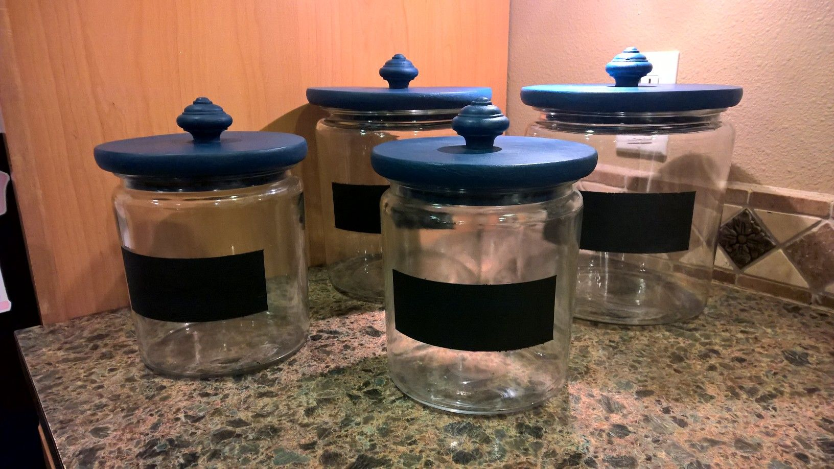 Kitchen cannisters painted in Napoleonic Blue by Annette.