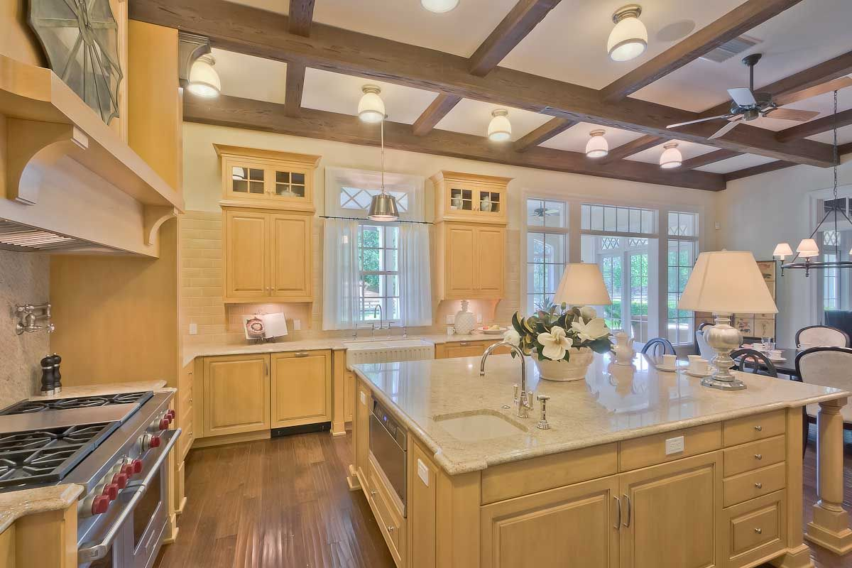 This gourmet kitchen with custom maple cabinets, beautiful ...