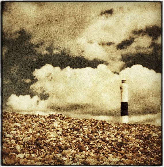 Lighthouse on a Warm Pebbly Beach  golden brown by matthewbull