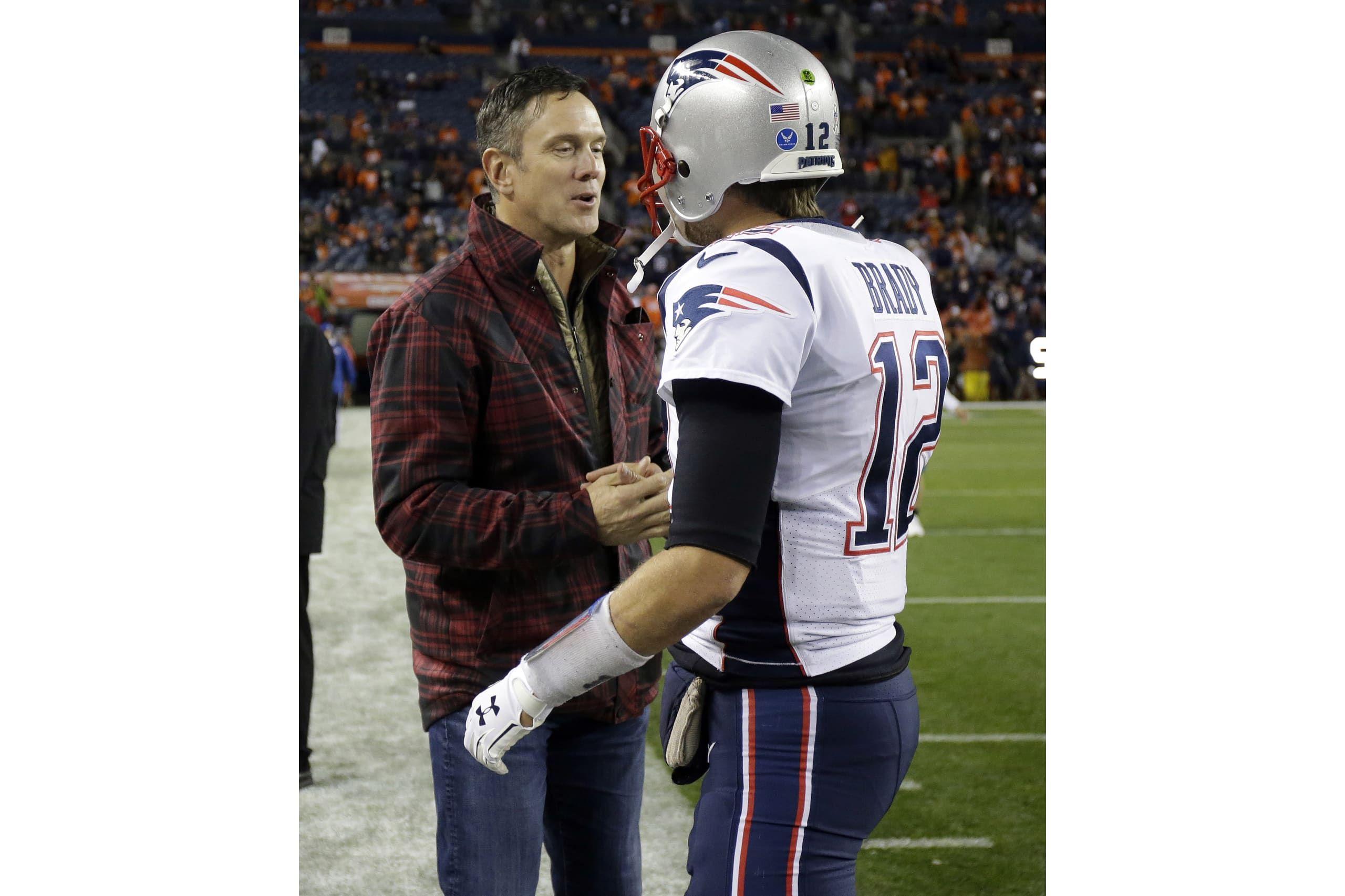 New England Patriots Quarterback Tom Brady 12 Greets Retired Patriots Quarterback Drew Bledsoe Prior To An Nfl Football G Nfl Football Games Patriots Broncos