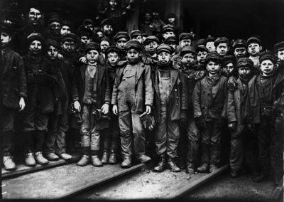 This is a photograph of breaker boys – child labour used to separate coal from slate. This image helped lead the nation to outlaw child labour. The photo was taken by Lewis Hine who travelled the United States taking photographs of child labourers...Pennsylvania 1910