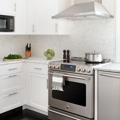 Grey black tile with white cabinets