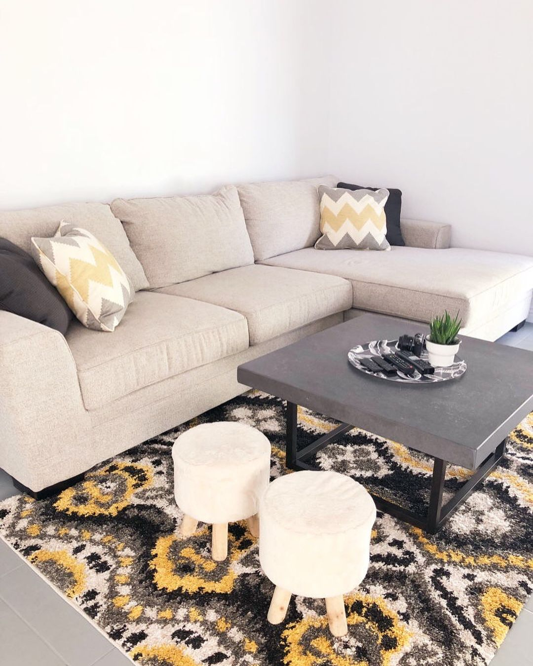 Black Yellow Accented Livingroom Featuring The Delano Sectional Sectional Luxury Living Living Spaces Furniture