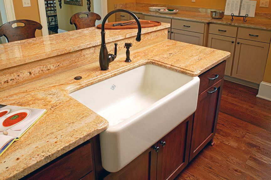 Two Tier Counter With Granite Backsplash Farm Style Sink
