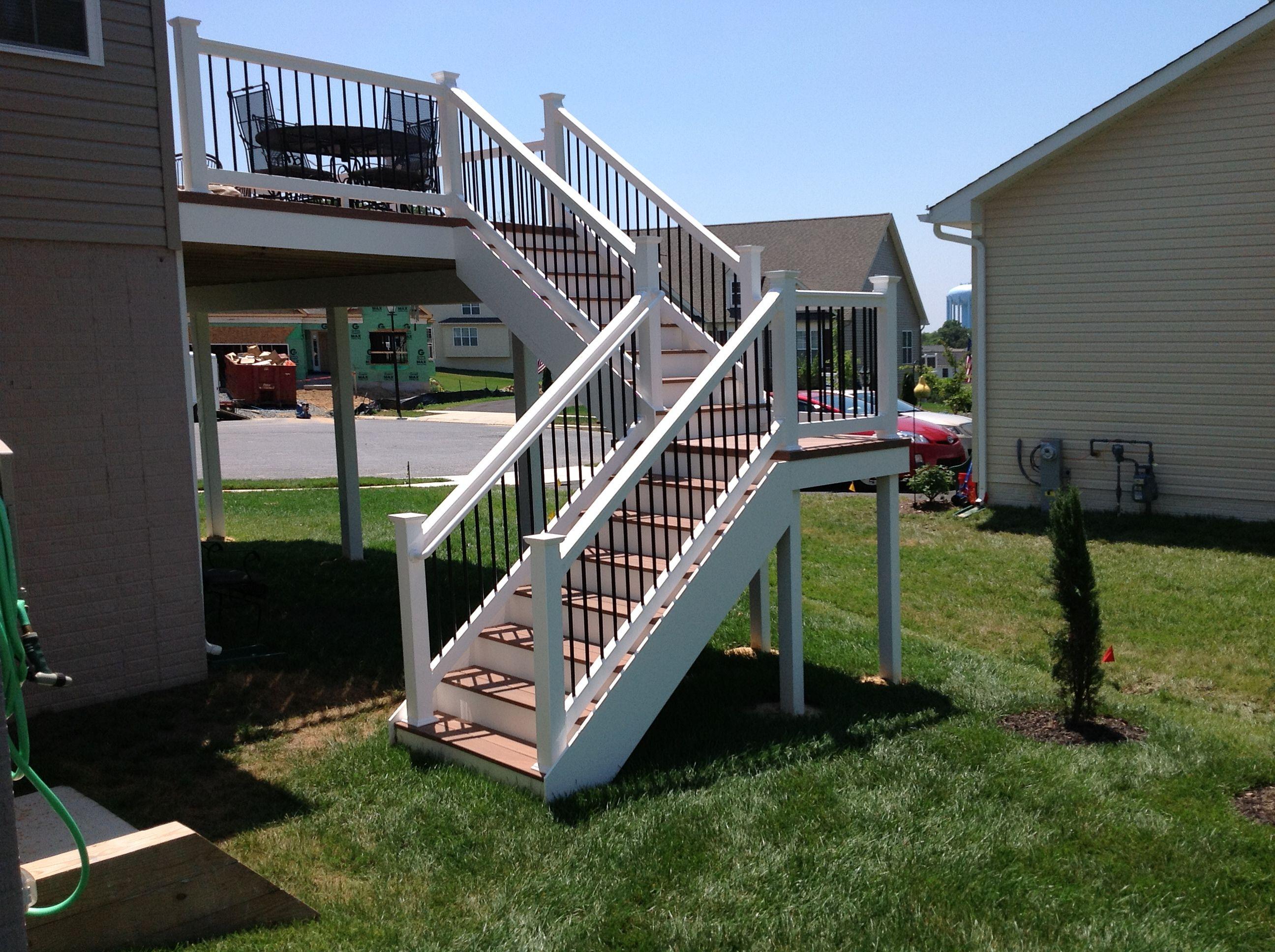 vinyl split deck staircase using wolf pvc decking amberwood
