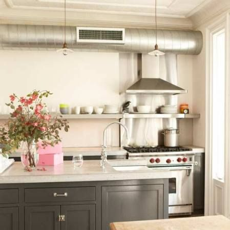 industrial chic stove with heater shelf, exposed duct work and hood ...