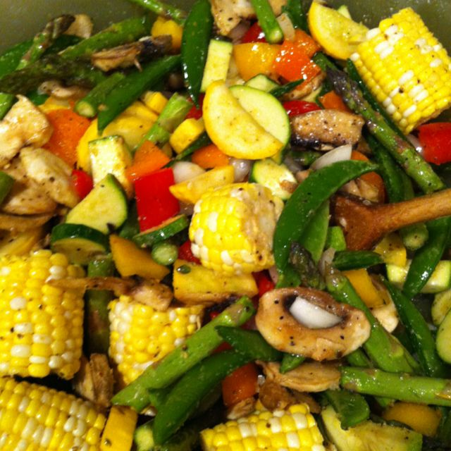Summer veggie mix. Zucchini, asparagus, mushrooms, tomatoes, sweet corn, snap peas, yellow squash & sweet onion mixed with garlic powder, lemon pepper, and beau monde with Olive oil. Can be served chilled or grilled. Cover veggies in seasoning to taste.