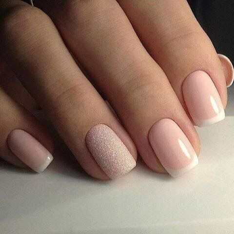 Light pink nails with white tips and a glitter accent ...