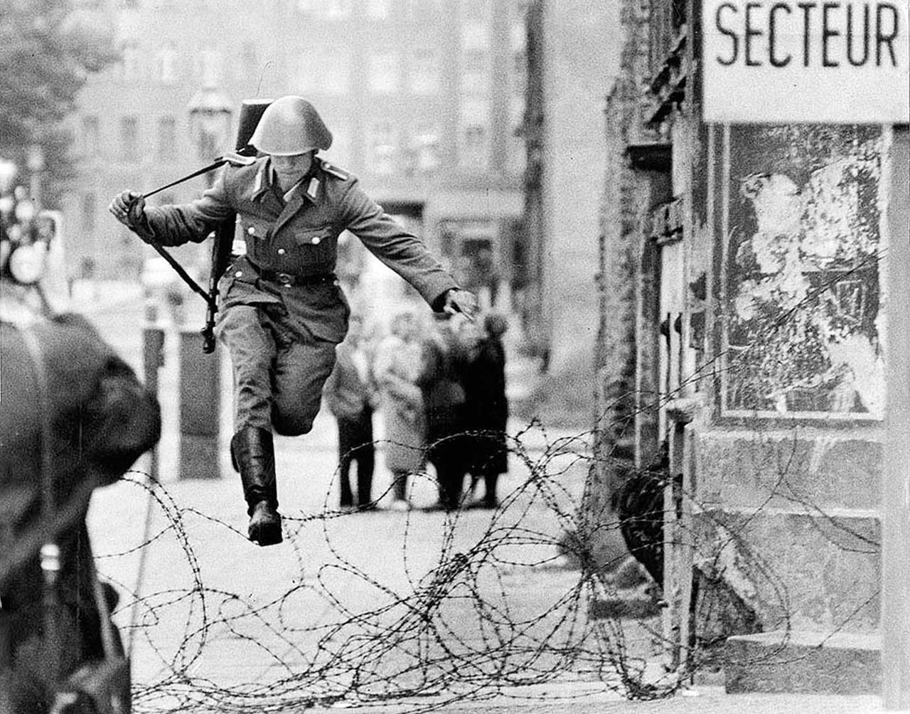 19 year old East German soldier Conrad Schumann jumping the barbed ...