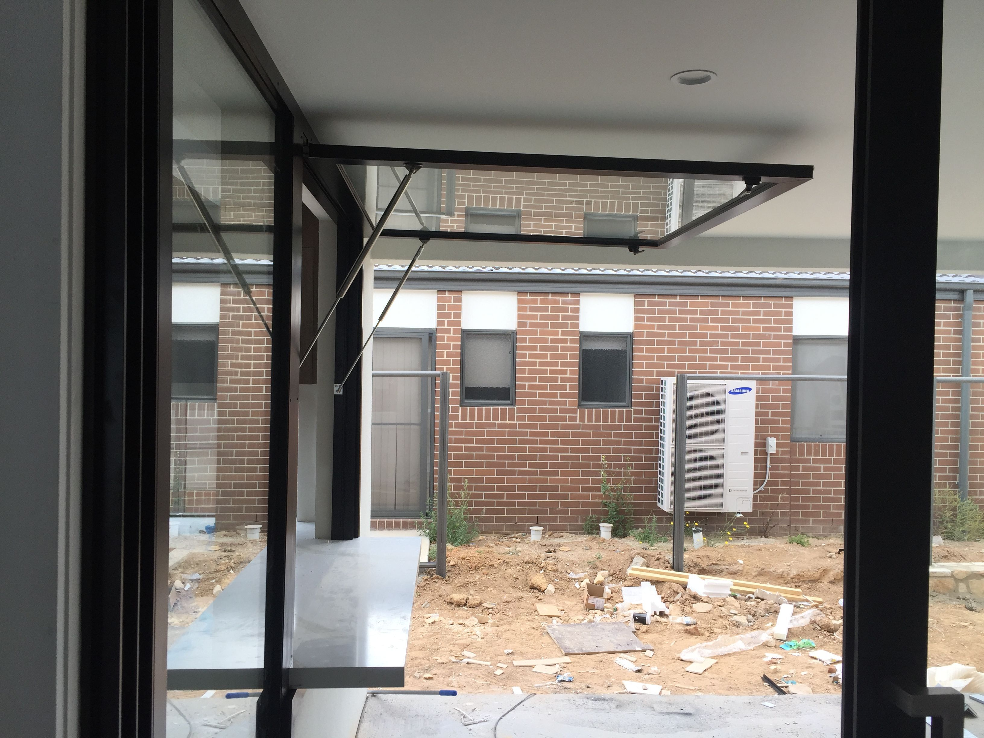 A side view of the cga gas strutted awning window for Pictures of awning windows