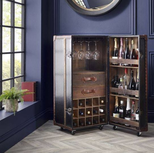 A fantastic addition to your hosting capabilities with this amazing drinks cabinet on castors, storage for your 30 favourite bottles of wine,champagne or prosecco. Two Internal drawers for extra storage finished off with tanned leather wooden inserts and robust edging to give extra design appeal. Sure to catch the eye and be the envy of your guests. #entertaining #dining #homedecor #interiors #interiordesign #homeinteriors #homegoals #DefineYourLifestyle #TurnbullandThomas