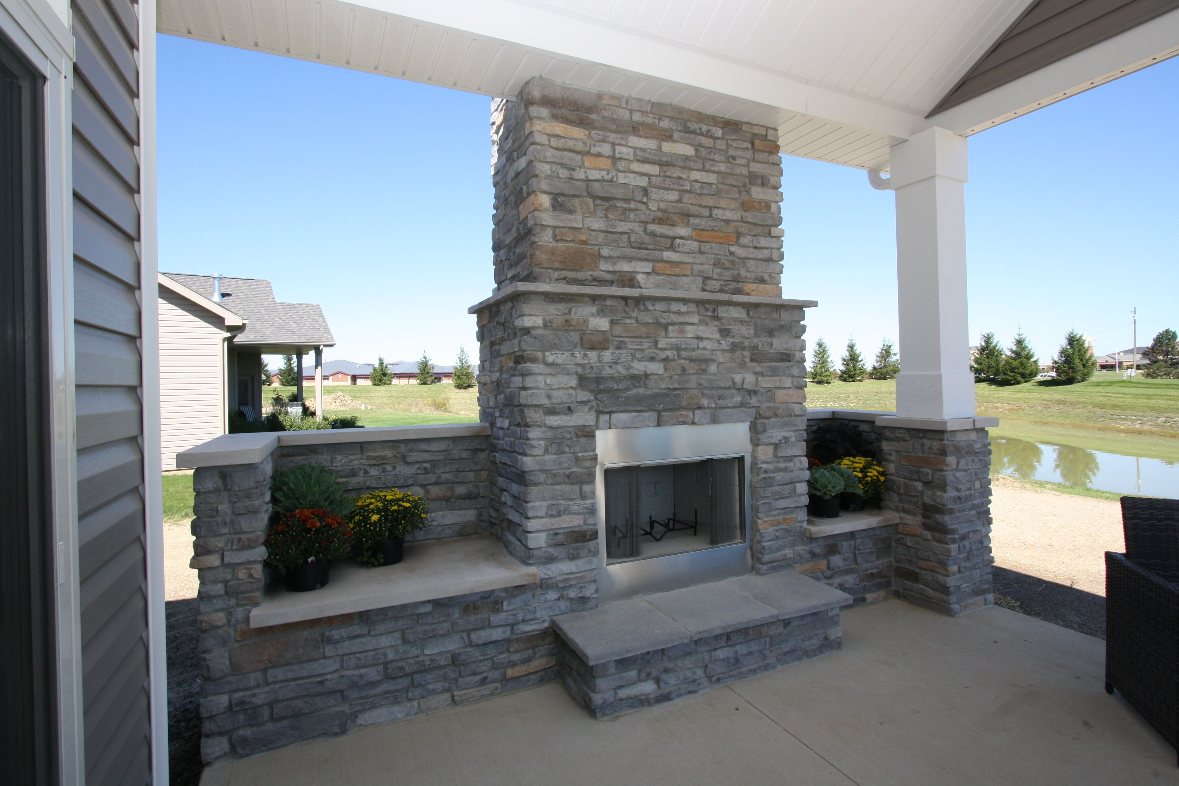 stoned outdoor fireplace covered porch mystic gray laytite j n stone