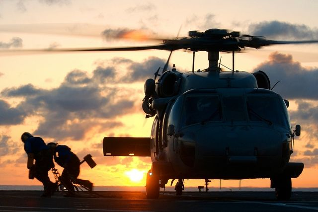 Stock Photo of a Military Helicopter on the Flight Deck of an ...