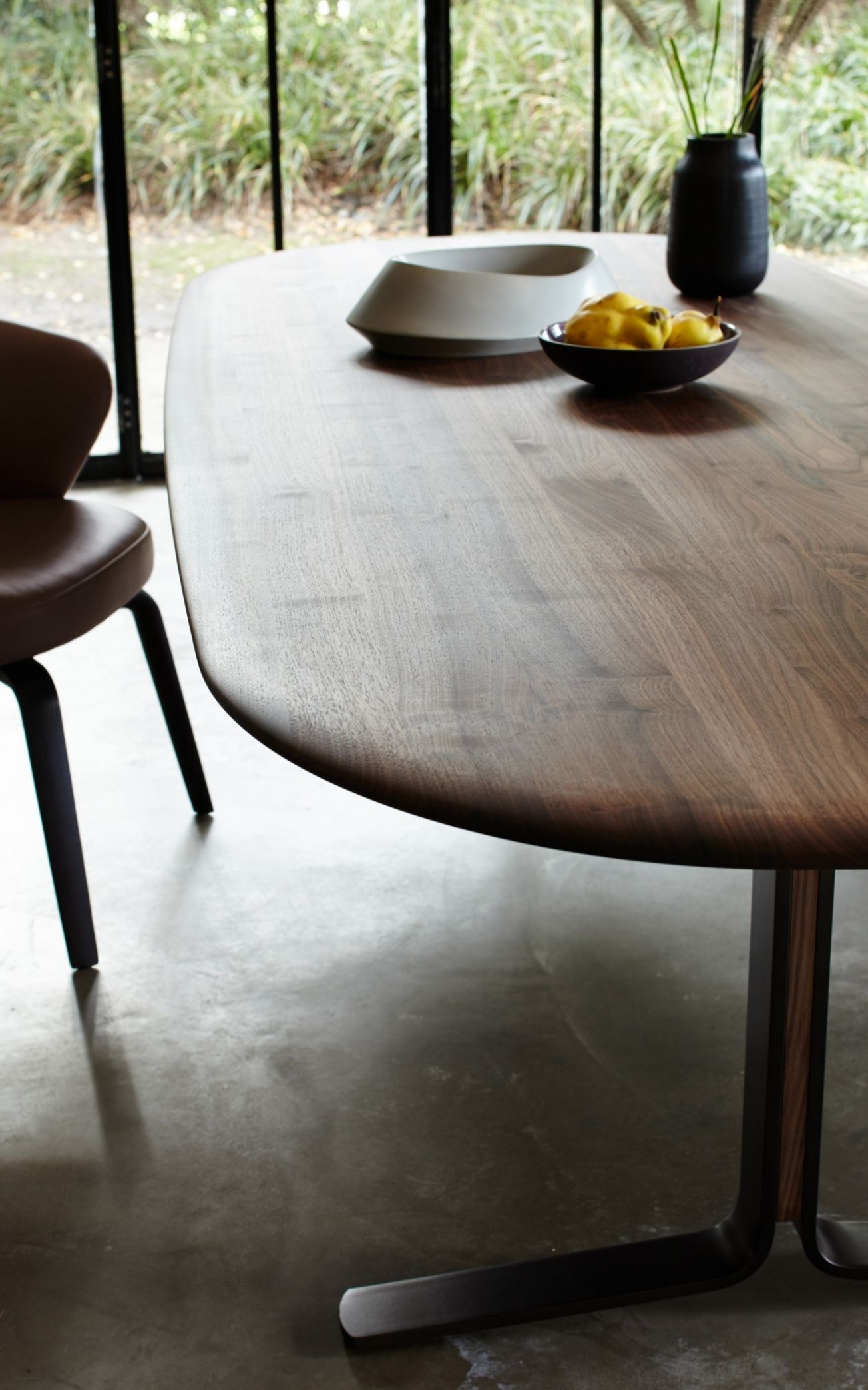 The cesar dining table features curved wood edges for a smooth contemporary design available