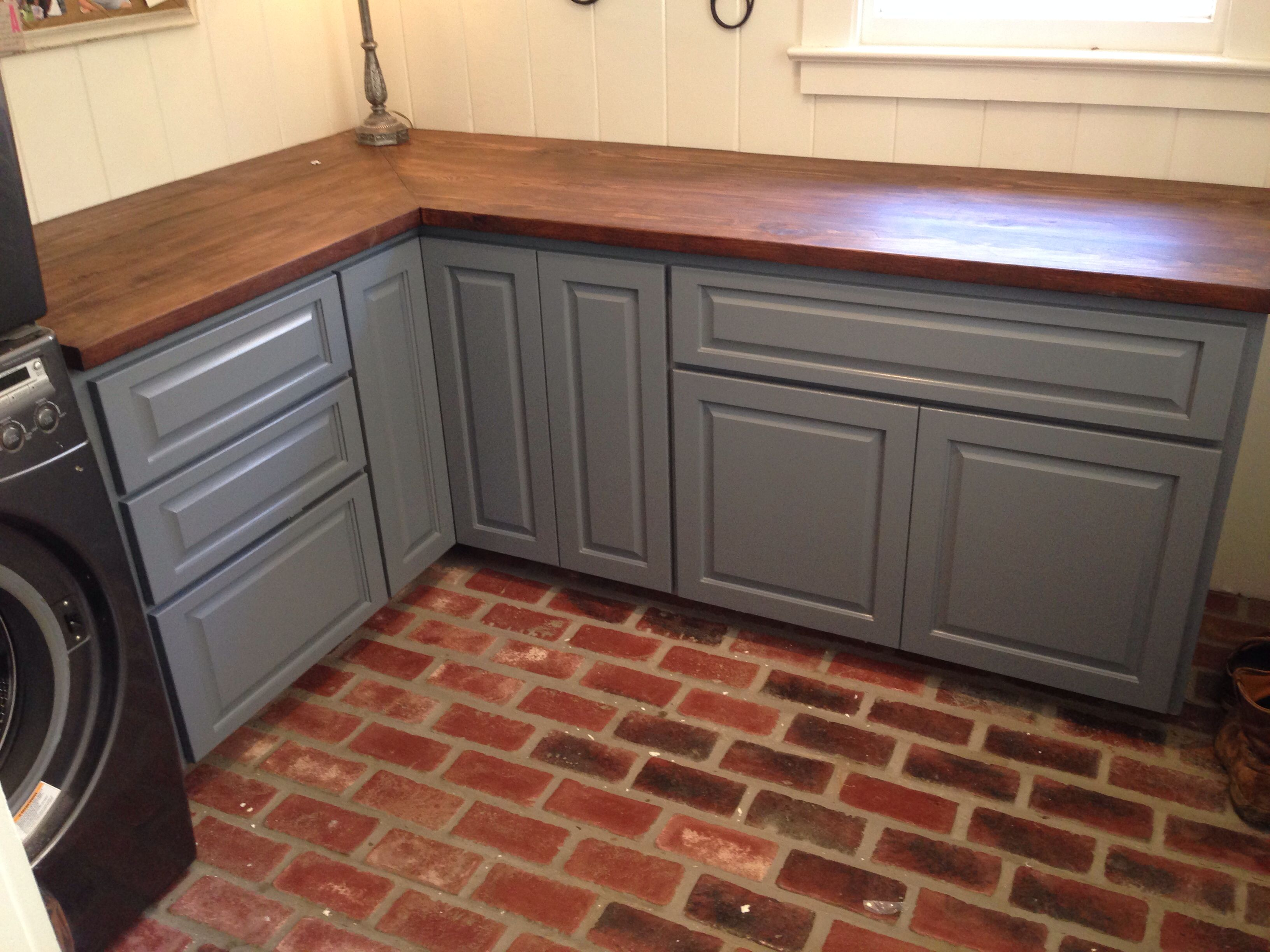 Laundry Room Brick Floor Stained Wood Countertop And Blue