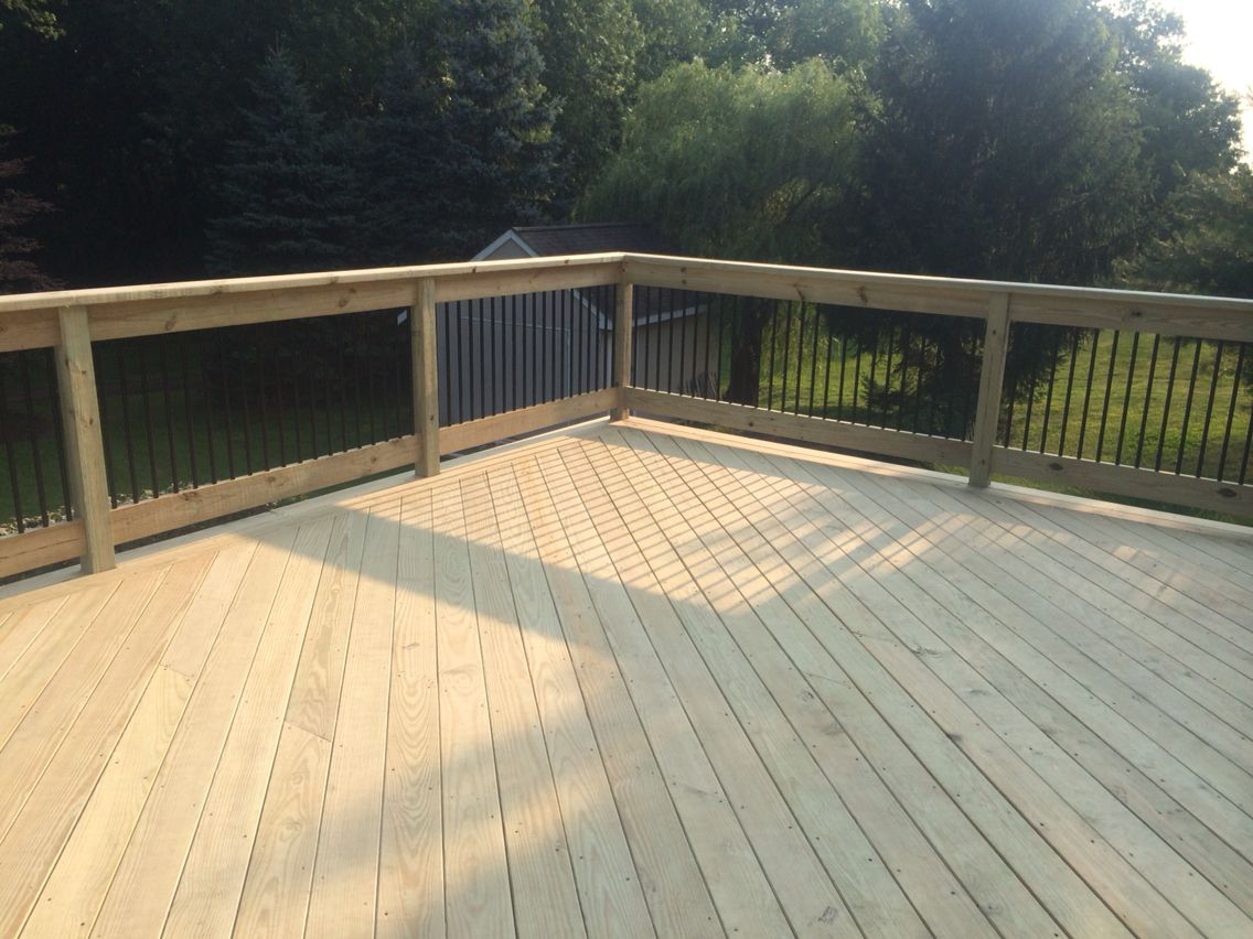 Wood deck with black balusters