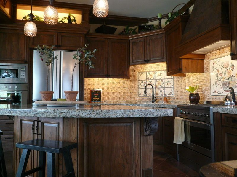 The kitchen of Estuary features all of the amenities and more, including statement lighting and tiled walls.