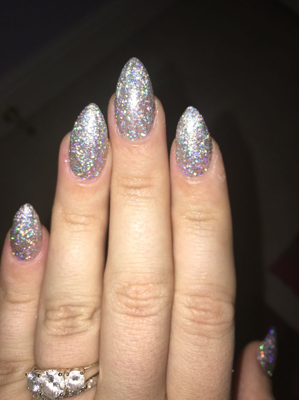 Silver glitter almond stiletto nsi acrylic nails
