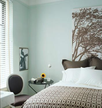 Domino Magazine Blue brown comfy bedroom design with Marimekko