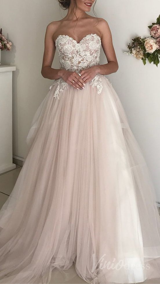 Gorgeous blush beach wedding dress with beaded bodice.