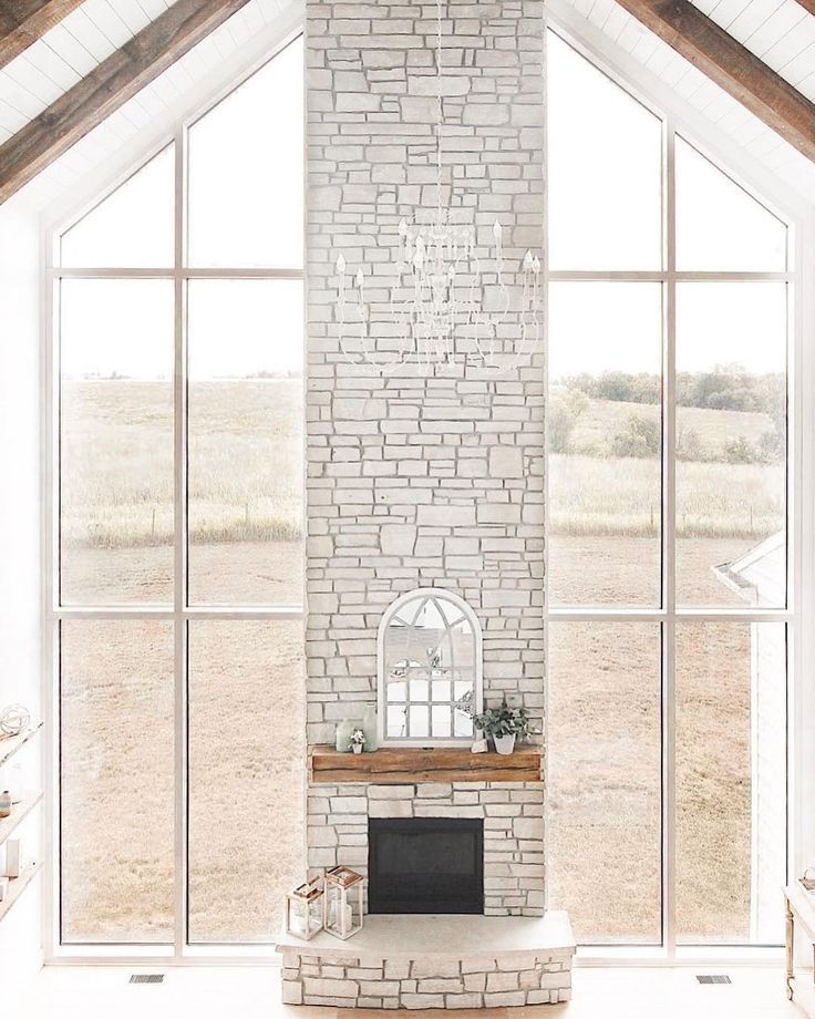 living room fireplace window wall, vaulted ceilings, wood beam ceiling | Niña and Cecilia @ninaandcecilia #vaultedceilingdecor