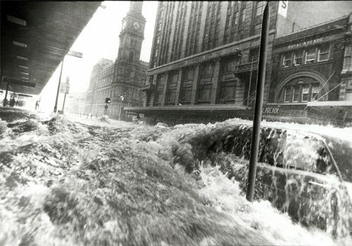 A wall of water running down Elizabeth Street, Melbourne 1972. Photo: Neville Bowler