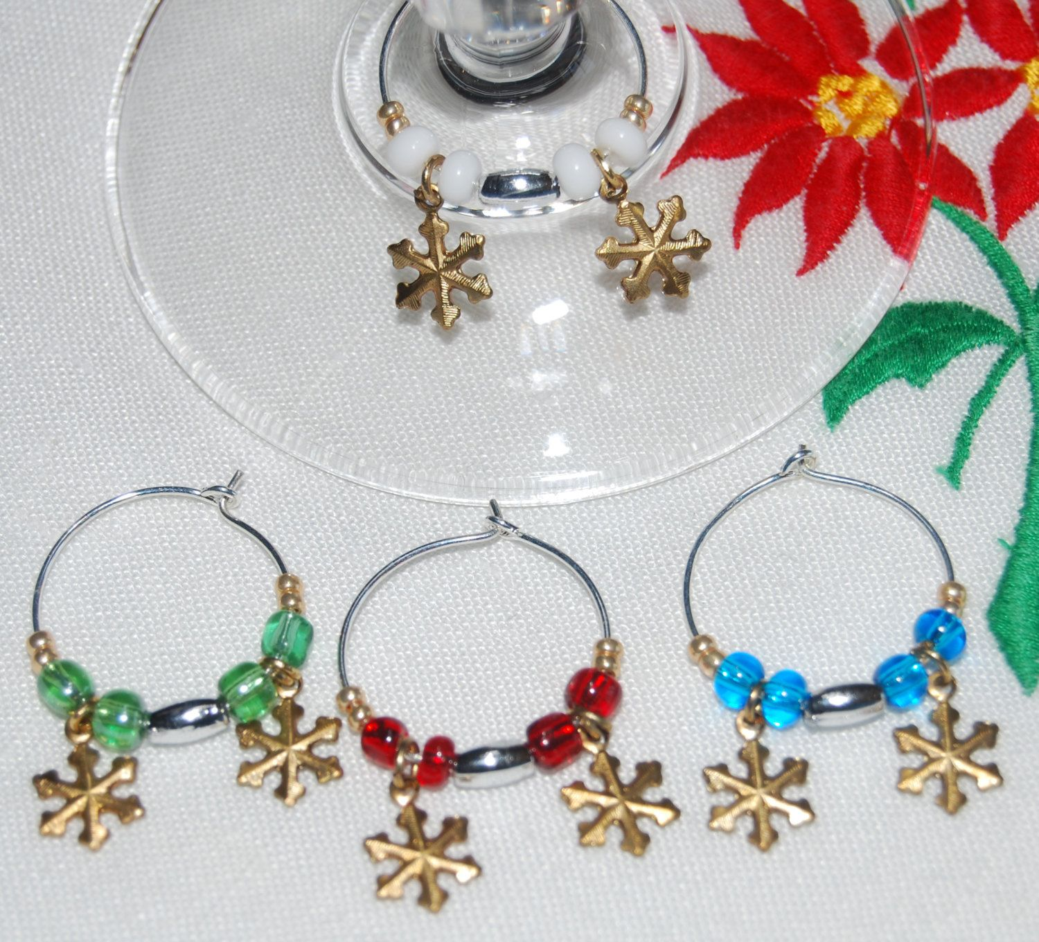 Snowflake Wine Charms. Gold Double SNOWFLAKE Wine Charms! Beautifully beaded Wine Charm with 2 Gold Snowflake Charms. - pinned by pin4etsy.com