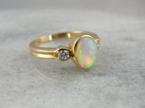 Contemporary Ladies Opal And Diamond Bezel Set Ring by MSJewelers