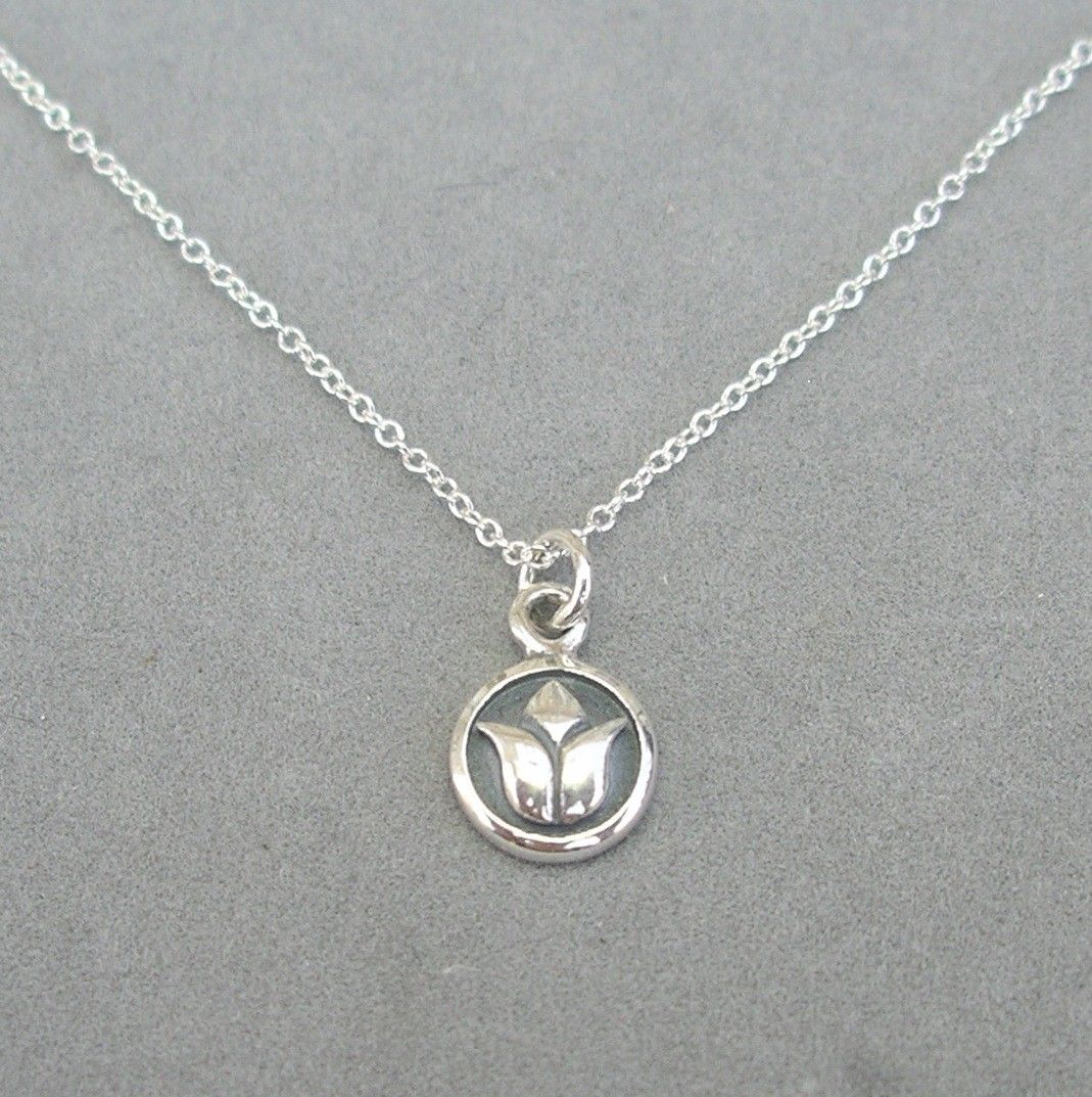 tiny silver lotus charm necklace. $30.00, via Etsy.