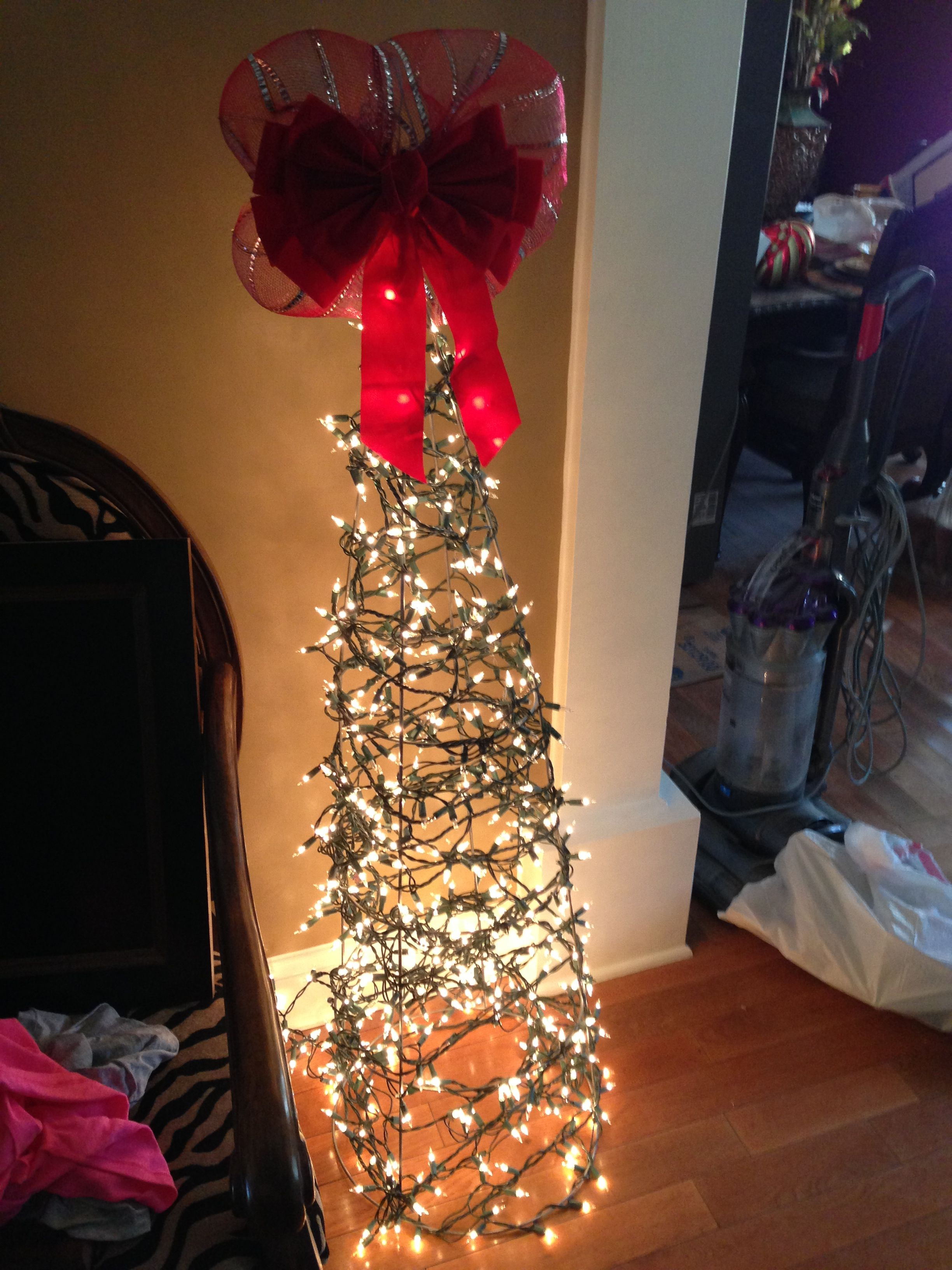 3 ft Outdoor Christmas tree that I made out of tomato cages & extra