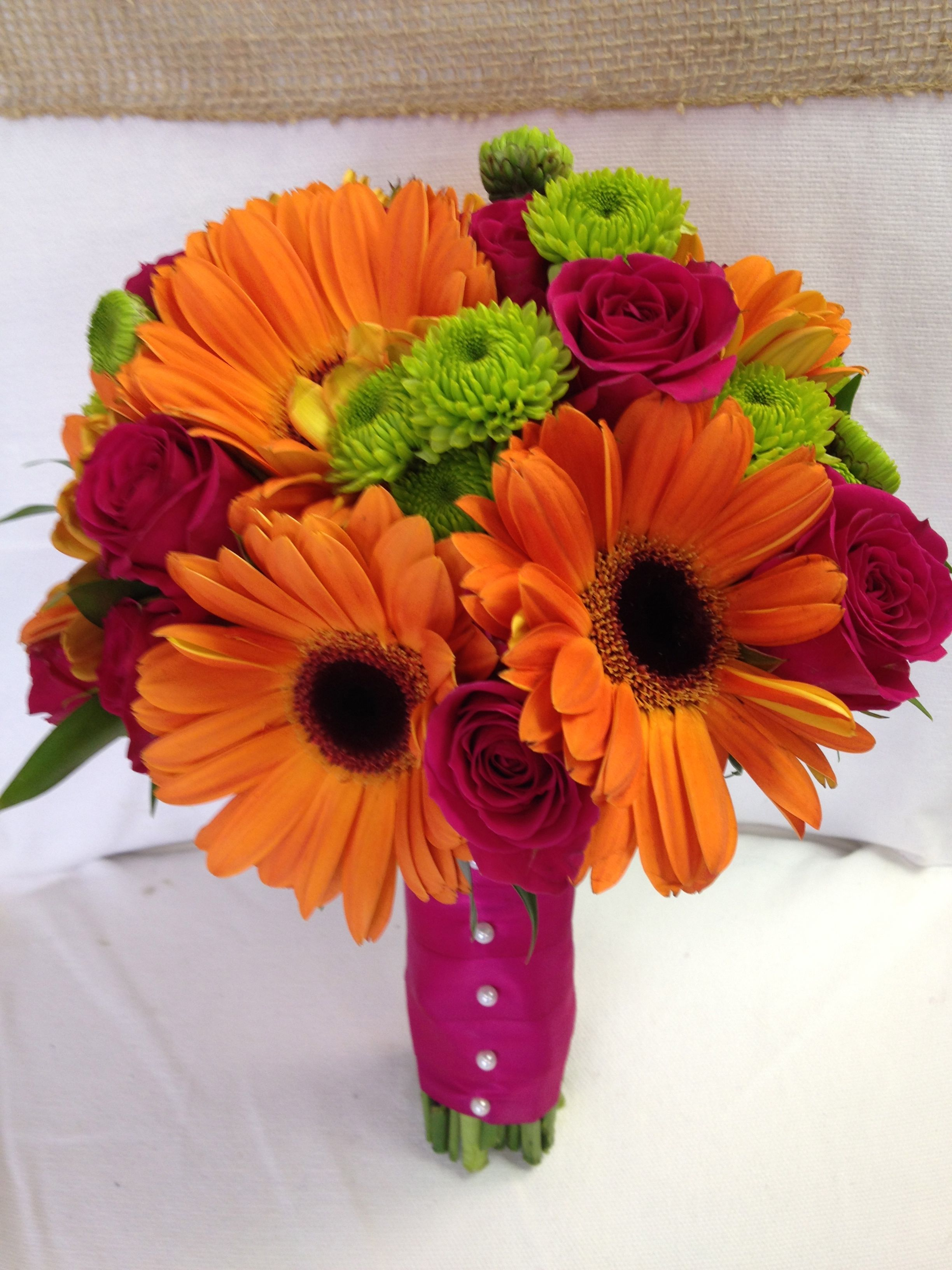 Vibrant orange gerber daisies , green button mums and hot