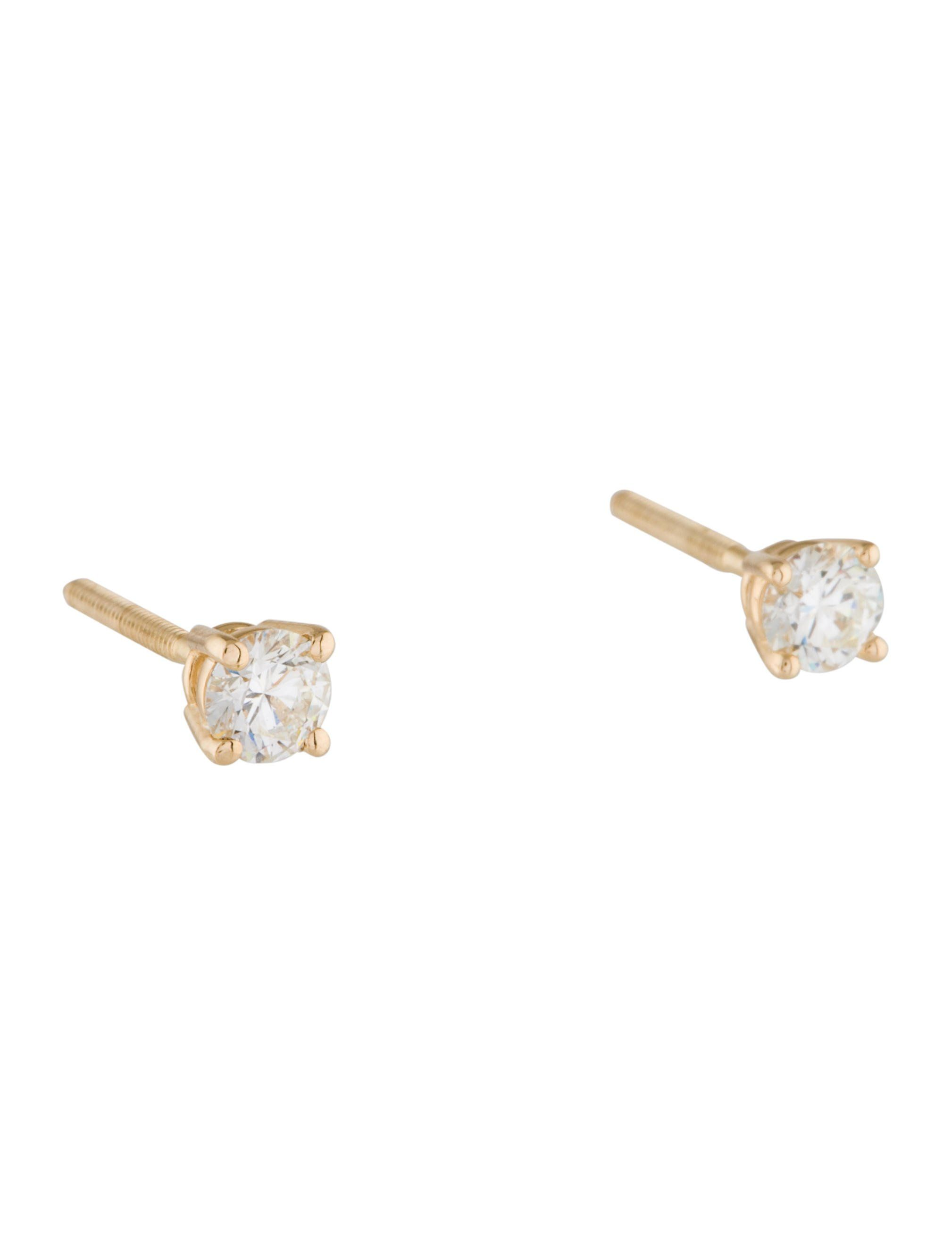 6a6be5b28 14K yellow gold stud earrings featuring 0.51 carats of round brilliant  diamonds and threaded screw back closures. Includes valuation report.