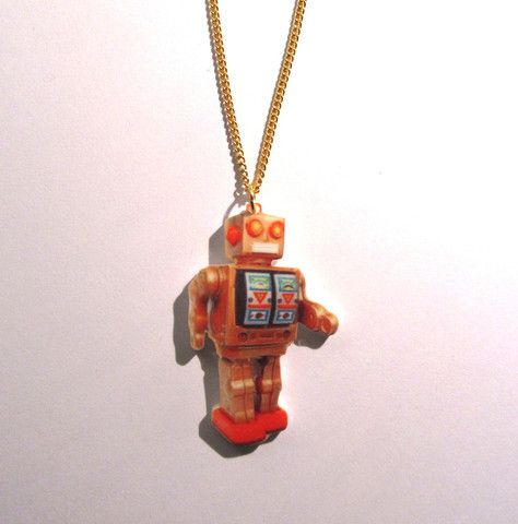 Retro Mr D-Cell Tin Robot Print Necklace. Relive your childhood (or someone else's!) with this brilliant Mr D-Cell Robot print retro necklace, fashioned from laser-cut acrylic. On a 46cm gold plated curb chain.  #jewellery #retro #necklace #pendant #robot #mrdcell #toys