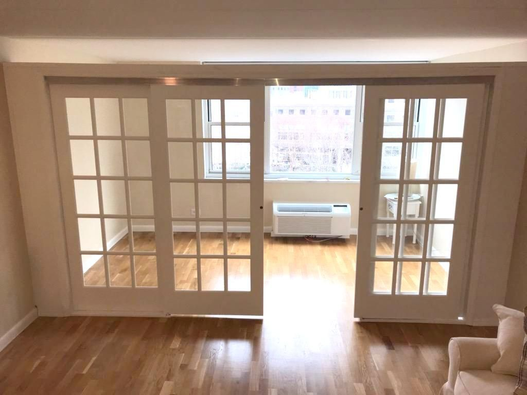 Sliding French Door Partition Call Us For All Your Custom Room Partition And Storage Wall Inquiries 646 8 Temporary Wall Bookcase Wall Sliding French Doors