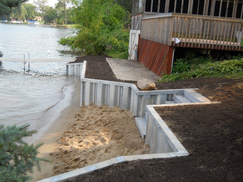 Seaside Seawalls Offers Dependable Marine Construction Services For Your Michigan Seawall And Seawall Repair Needs Lakefront Living Lake House Lake Landscaping