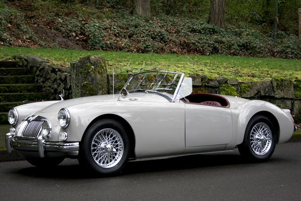 Beautiful 1960 MGA in rare Dove Gray. I drove a red one in High School, it had a black roof!!!