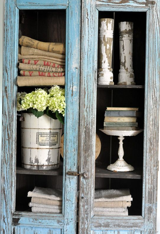 love this display.....especially the old books on the pedestal dish